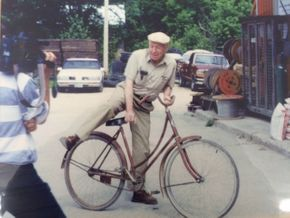 Frank Hamilton on his bicycle
